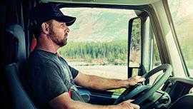 a man in a truck wearing a seatbelt