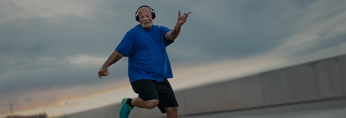 a person in blue T-shirt listening to music and dancing