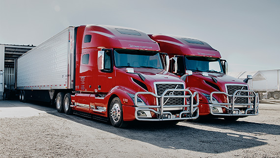 Two Volvo Trucks VNL standing next to each other