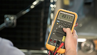 a multimeter in use