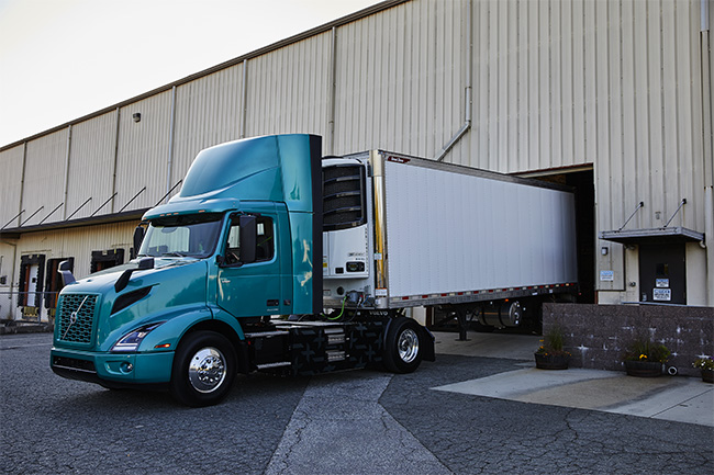 Volvo VNR Electric Pulling out of Loading Dock