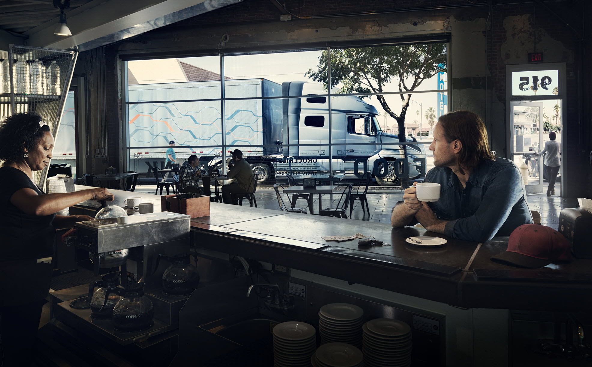 Volvo Truck passing by a coffee shop
